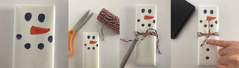 Add buttons and a muffler to your chocolate bar snowman