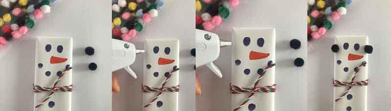 Glue the earmuffs on your chocolate bar snowman